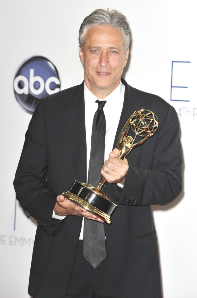 Jon Stewart with an Emmy