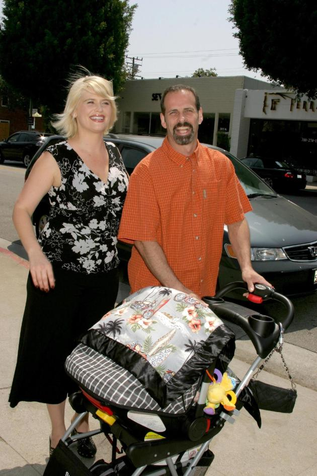 Kristy Swanson And Lloyd Eisler And Child