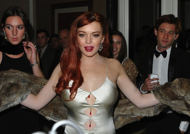 Lohan Busts Out