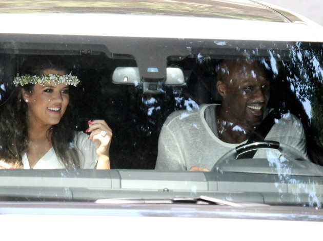 Lamar Odom and Khloe Kardashian in a Car