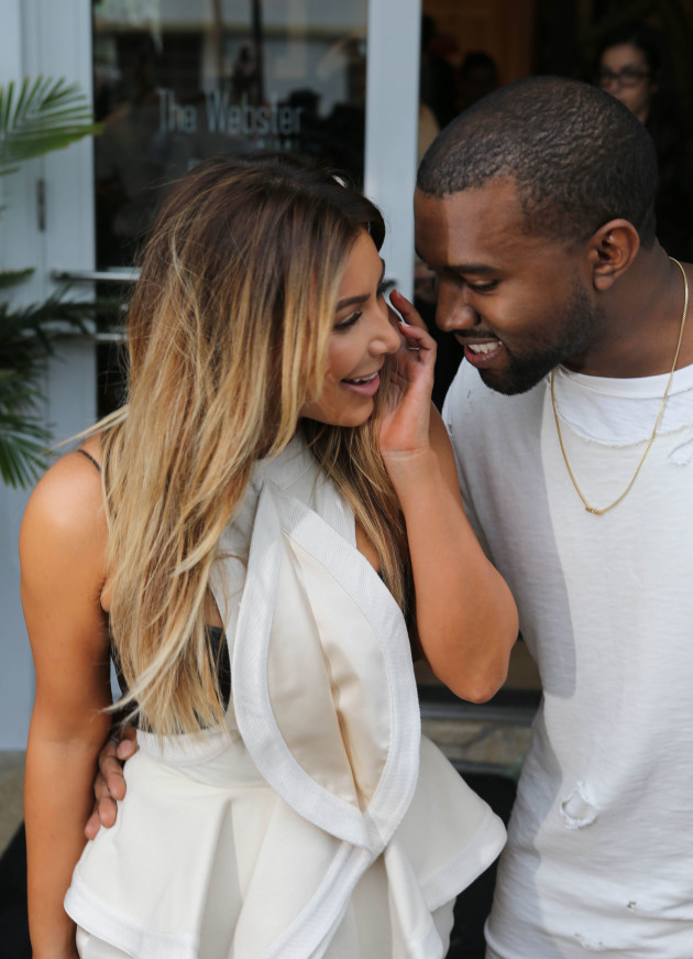 Smiling Kanye West and Kim Kardashian