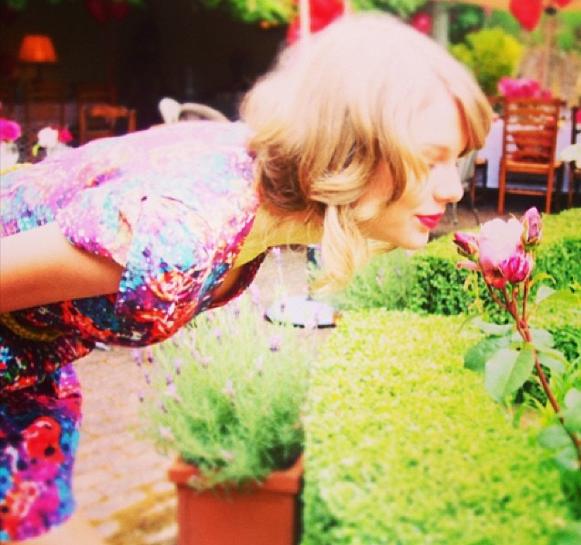 Taylor Swift Smells a Flower