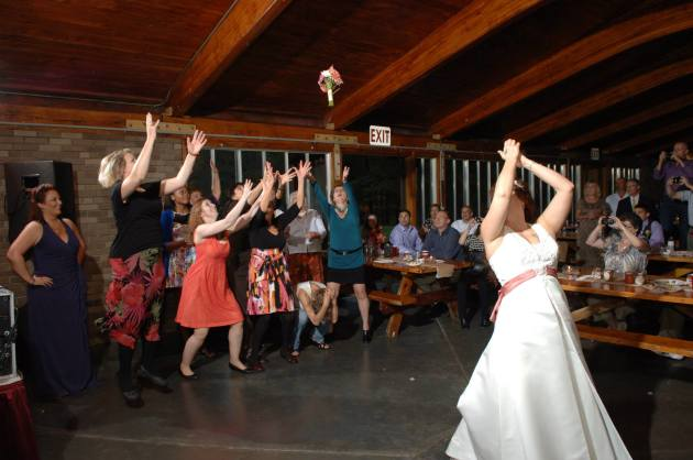 Woman Ducks Bouquet Toss