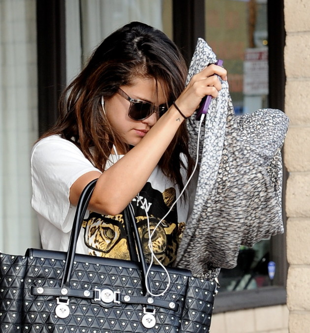 Selena Gomez Takes Cover
