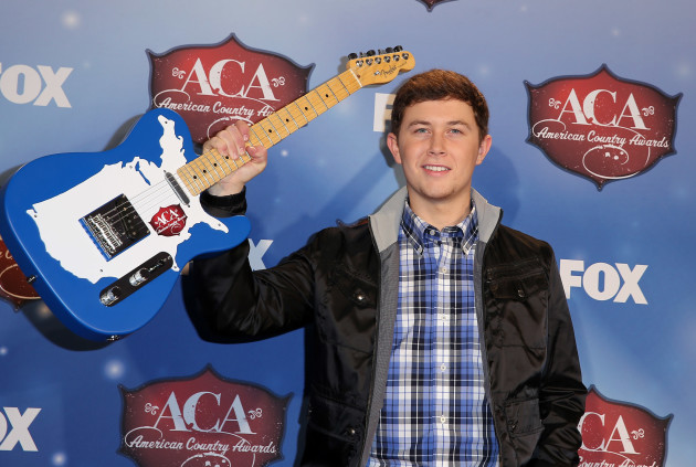 Scotty McCreery with a Guitar