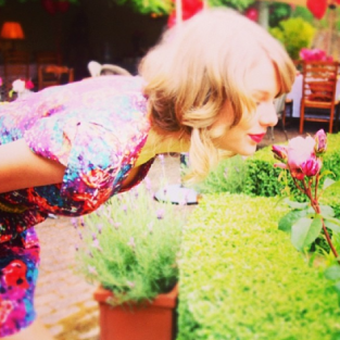 Taylor Swift Smells a Flower