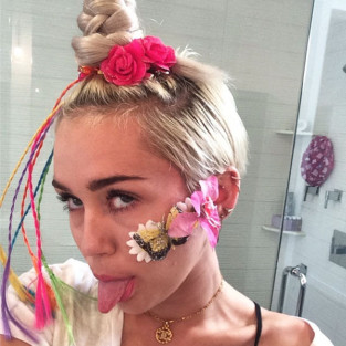 Miley Cyrus Covers Pimple