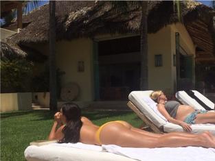 Kim Kardashian Sun Bathing