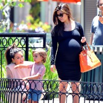 Pregnant Kourtney Kardashian and Mason