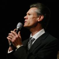 Randy travis sings