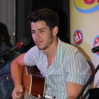 Nick Jonas on the Guitar