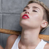 Miley Cyrus Holds Sledgehammer