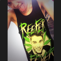 Miley Cyrus wearing a Justin Bieber weed shirt is...
