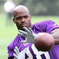 Adrian-peterson-with-a-football