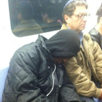 Stranger Sleeps on Subway Passenger