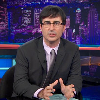 John oliver at the desk