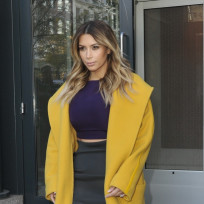 Kim kardashian with yellow coat