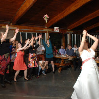Woman-ducks-bouquet-toss