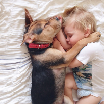 Dog-naps-with-baby