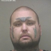 Man with Bentley Tattoo Mug Shot