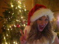 Hilary Duff Spreads Christmas Cheer on Pregnant Belly