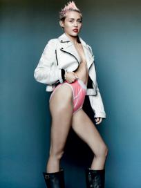 Miley Cyrus Bares Leg