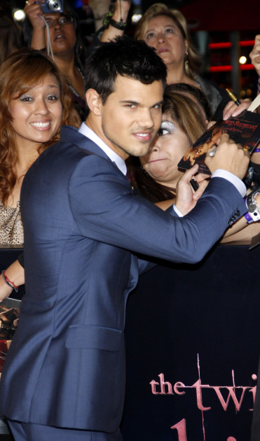 Taylor Lautner Signs for Fans