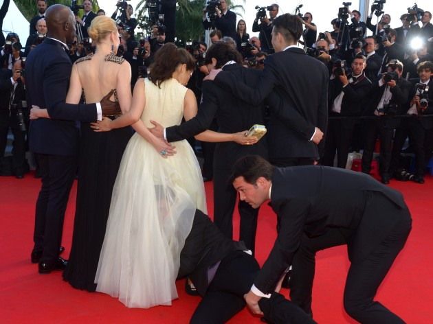 Guy Crawls Under America Ferrera's Dress