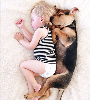 14 AWWW-Inspiring Photos of a Baby and Dog Napping