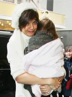 Cradling Suri Cruise