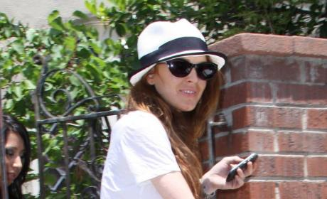 Lindsay Lohan Smiles Through the Pain