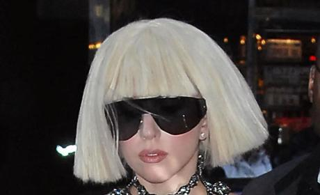 Lady GaGa Sheltered By Massive Dome of Hair
