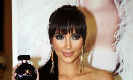 Kim Kardashian Shows Off New Bangs, Old Breasts