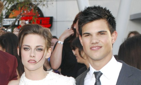 Taylor Lautner: Torn Between Lily Collins and Kristen Stewart?