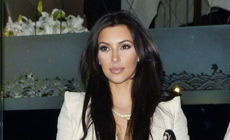 Kim Kardashian Spreads Legs, Awaits Reggie Bush