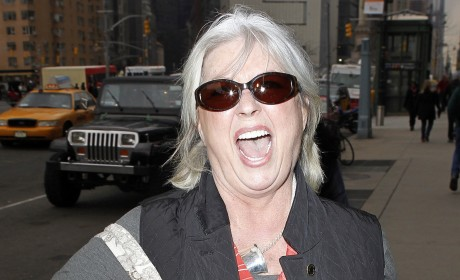 Paula Deen Chows on Burger on Vacation