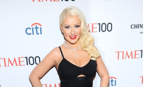 Who wears her dress better: Christina Aguilera or Olivia Munn?