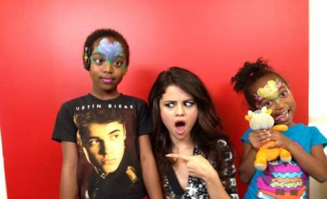 Selena Gomez Poses with Justin Bieber Fan, Makes Silly Face
