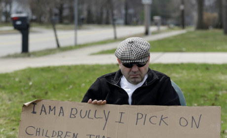 Judge Orders 62-Year Old Bully to Hold Up Shameful Sign in Public