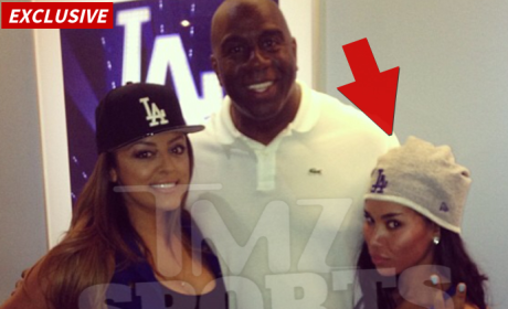 V Stiviano and Magic Johnson
