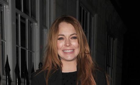 Lindsay Lohan Tries to Smile