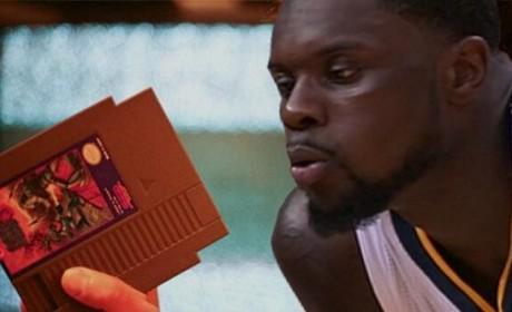 Lance Stephenson Blows on a Nintendo Cartridge