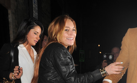 Lindsay Lohan Stumbles in London