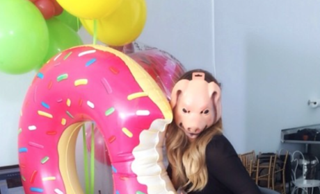 Khloe Kardashian Dresses in Pig Mask, Poses Near Inflatable Donut