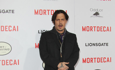 Johnny Depp Rolls Solo to Mortdecai Premiere, Forgets Anniversary With Amber Heard