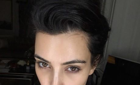 Kim Kardashian Makes Like Miley Cyrus