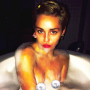 Miley Cyrus Goes Topless Again, Shows Off Daisy and Disco Titties