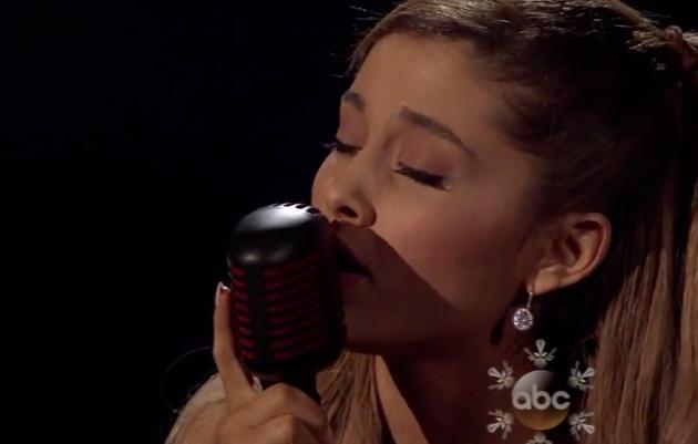 Ariana grande strips down tattooed heart at american for Tattooed heart ariana grande