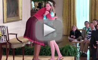 Girl Hands Michelle Obama Her Father's Resume
