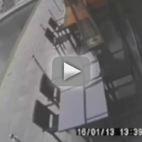 Texting Woman Falls Into Canal
